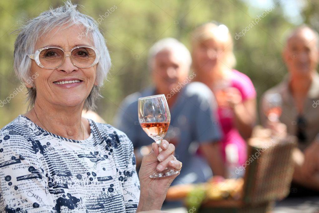 Mature couples enjoying a picnic.