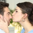 Woman kissing her boyfriend — Stock Photo