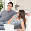 Couple lying on a couch together — Stock Photo