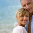 Couple stood hugging on romantic beach — Stock Photo #8551648
