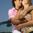 Couple stood by cabriolet - Stock Photo