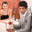 Stock Photo: Guy inviting his belle to restaurant