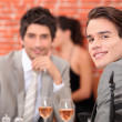 Friends having lunch in a restaurant — Stock Photo #8551909