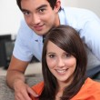 Teenage couple with television remote control — Stock Photo #8552330