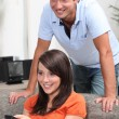 Young woman and young man watching TV — Stock Photo