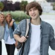 Teenagers going to college — Stock Photo