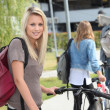 Stock Photo: Beautiful girl go to university with her friends