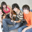 Young with a guitar — Stock Photo