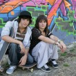 Boy and girl skateboarding together — Stock Photo #8552569