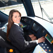 Stock Photo: Female tram conductor sat at controls