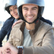 Stock Photo: Man and woman smiling on a motorcycle