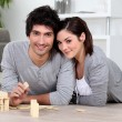 Stock Photo: Couple playing dominoes