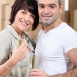 Stock Photo: Couple celebrating their move