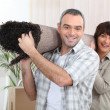Couple carrying rug — Stock Photo #8553126