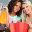 Girls after shopping frenzy — Stock Photo