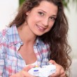 Woman playing video games — Stock Photo