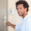 Man putting key in door — Stock Photo