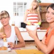 Women eating breakfast — Stock Photo