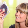 Woman holding CDs — Stock Photo #8553411