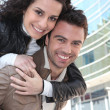 Young woman on her boyfriend's back — Stock Photo