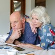 Elderly couple having breakfast in bed - Foto de Stock