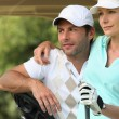 Stock Photo: Couple playing golf