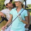 Couple in golf buggy — Stock Photo #8554857