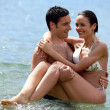 Couple stood in the sea - 