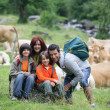 Family on a walk in the country — Stock Photo