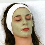 Woman receving facial at day spa — Stock Photo #8555741