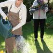 Young woman gardening with her grandmother — Stock Photo #8555934