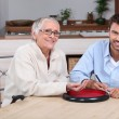 Young man playing with senior woman — Stock Photo #8555966
