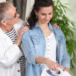 Young woman doing some ironing for an elderly lady — Stock Photo