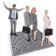 Businesspeople stood by maze — Foto de Stock