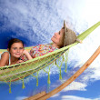 Stock Photo: Mother and daughter relaxing on hammock