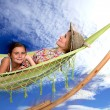 Mother and daughter relaxing on the hammock — Stock Photo
