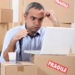 Stressed warehouse worker — Stock Photo