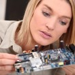 Woman repairing pc - Stock Photo