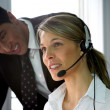 Stock Photo: Call-center colleague being supervised