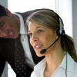 Call-center colleague being supervised — Stock Photo