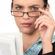 Woman in glasses reading a newspaper — Stock Photo