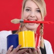 Portrait of female painter holding brush between her teeth — Stock Photo #8557064