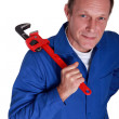 Plumber with large adjustable wrench — Stock Photo #8557158