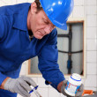 Stockfoto: Skilled technicirepairing canalizations