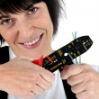 Woman with a wire stripper — Stock Photo