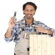 Woodworker holding cell phone — Stock Photo #8557218