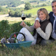 Couple tasting wine in a vineyard — Stock Photo #8557296