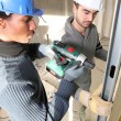 Stock Photo: Tradesmen installing drywall