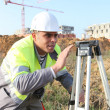 Stock Photo: Surveyor on a construction site