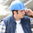 Stock Photo: Builder on phone